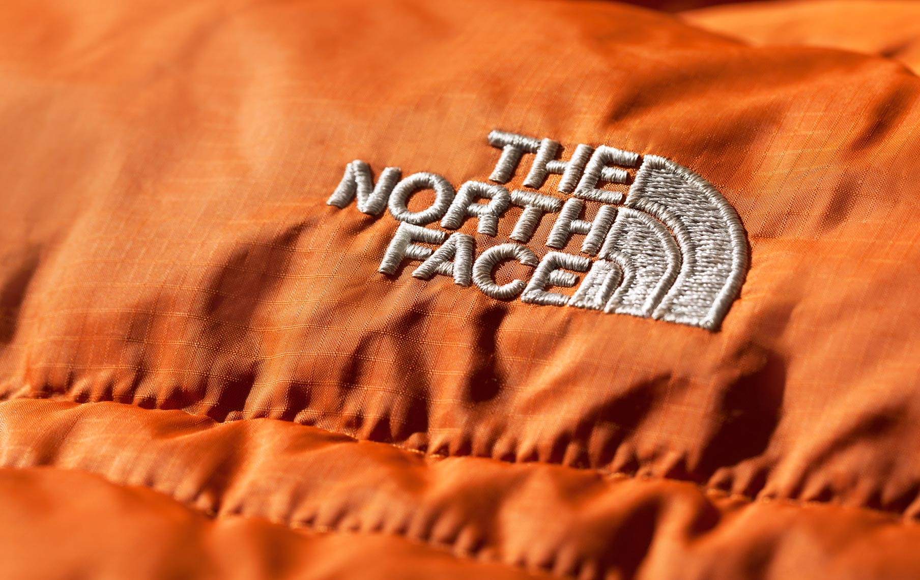 Product Photography Gear North Face Orange Puffer Jacket Logo Hiking Adventure Winter Sport Denver