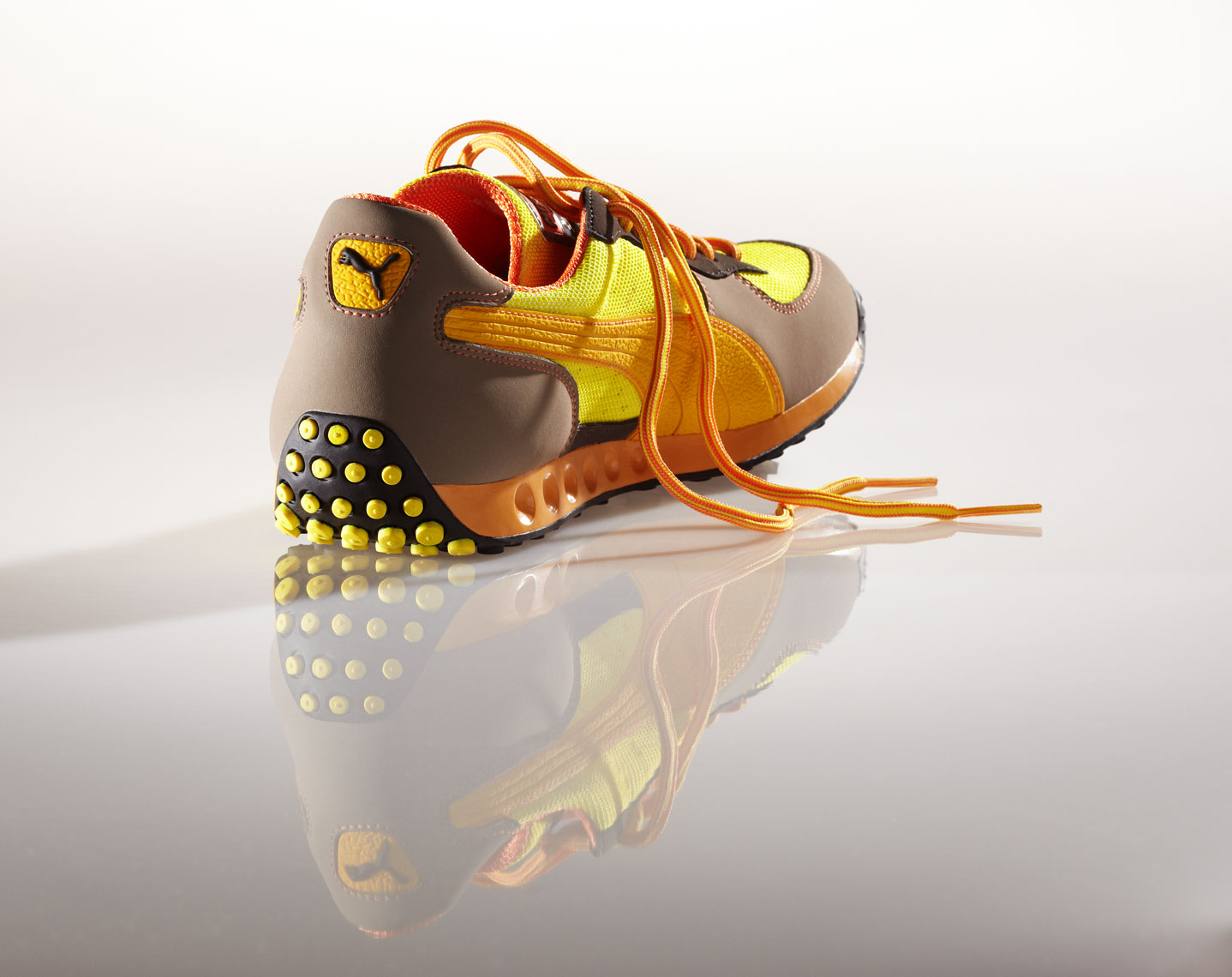 Product Photography Puma Gear Mens Fasion Casual Shoe Yellow Brown Orange with Reflection Chicago